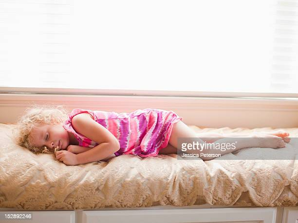 USA, Utah, Salt Lake, Girl (4-5) sleeping on bed
