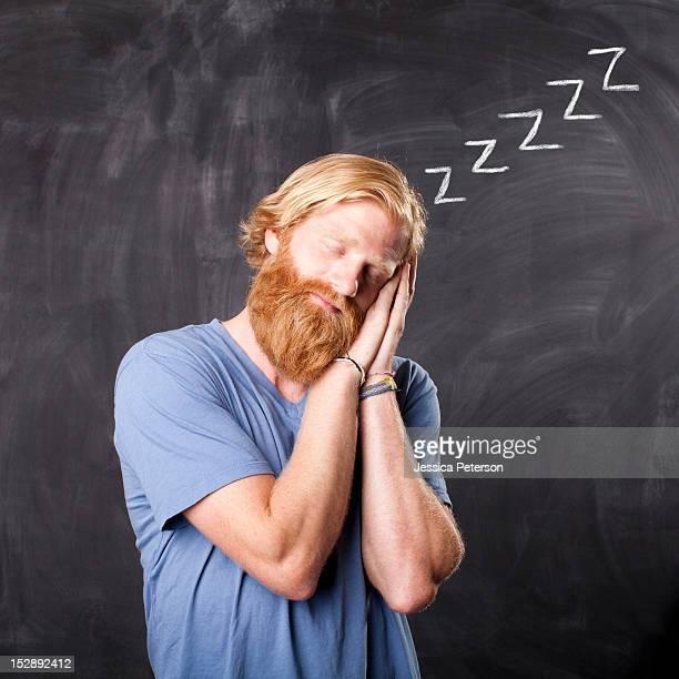 USA, Utah, Salt Lake, Man sleeping while standing in front of blackboard