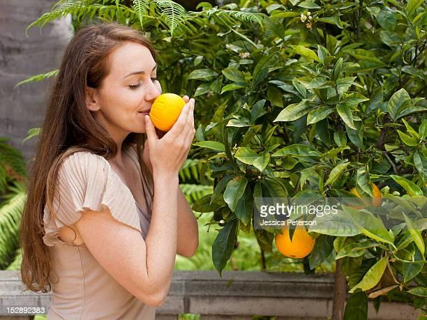 USA, Utah, Salt Lake, Young woman smelling orange