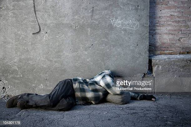 USA, Utah, Satl Lake City, homeless man sleeping in street