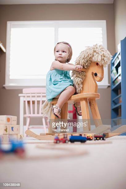 USA, Utah, small girl  (2-3) on rocking horse