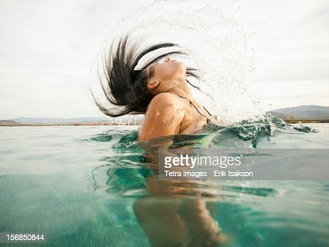 USA, Utah, St. George, Attractive young woman emerging from swimming pool