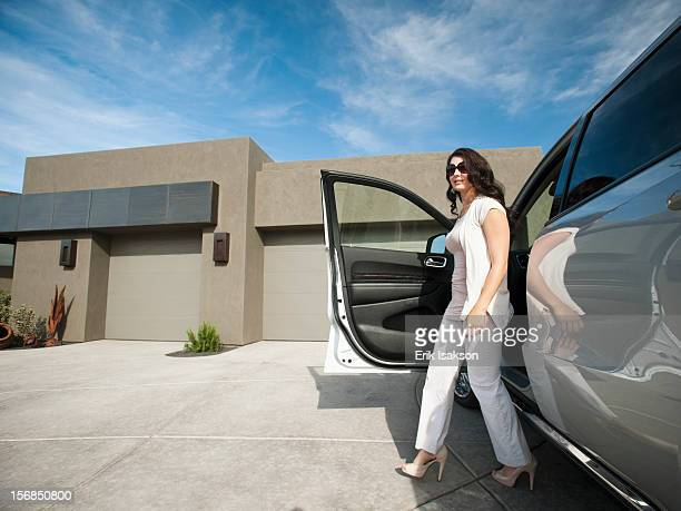 USA, Utah, St. George, Young woman getting off car