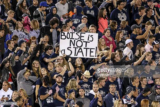 Utah State Aggies students celebrate a victory late in the second half of action between the Boise State Broncos and the Utah State Aggies on October...