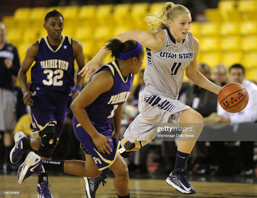 Utah State's Jenna Johnson, of Wasilla, breaks up court in front of Prairie View's Jeanette Jackson. Utah State played Prairie View A&M to open the women's Great Alaska Shootout on Tuesday, November 20, 2012 in Anchorage, Alaska.