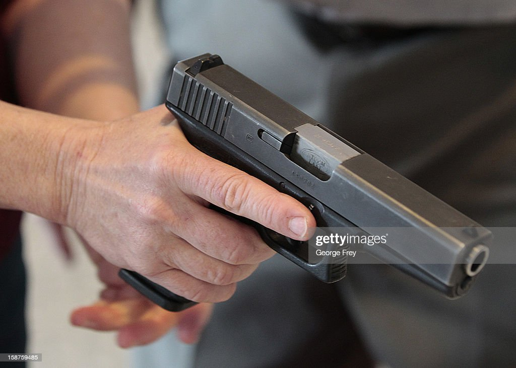 Utah teacher is shown how to handle a handgun by instructor Clint Simon at a concealedweapons training class to 200 Utah teachers on December 27 2012...