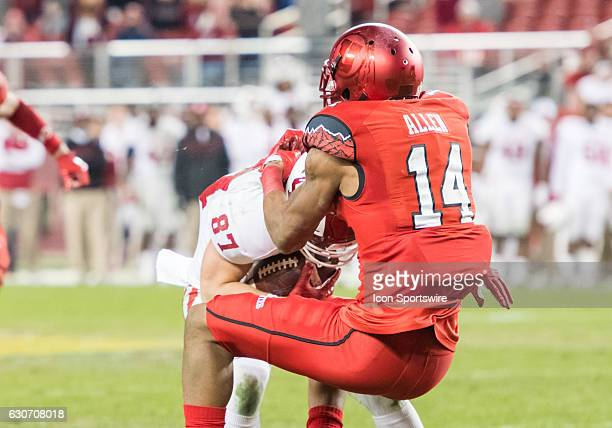 Utah Utes defensive back Brian Allen halts Indiana Hoosiers wide receiver Mitchell Paige after a pass completion during the Foster Farms Bowl game...