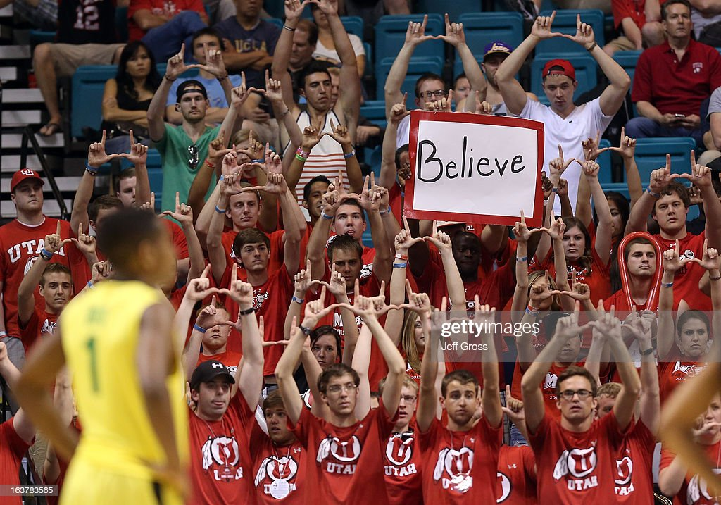 Utah Utes fans hold up a sign as Dominic Artis #1 of the Oregon Ducks looks on in the second half during the semifinals of the Pac-12 tournament at the MGM Grand Garden Arena on March 14, 2013 in Las Vegas, Nevada.