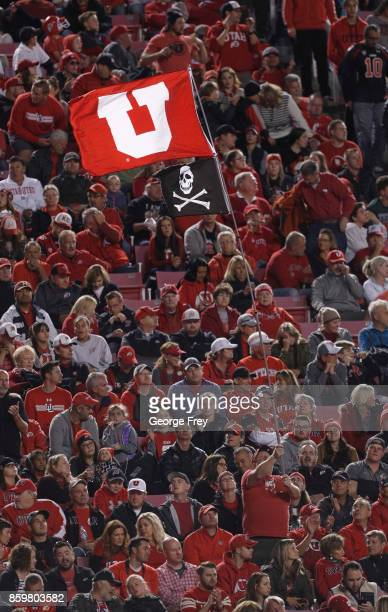Utah Utes fans wave a flag during the first half of an college football game against the Stanford Cardinal on October 7 2017 at Rice Eccles Stadium...