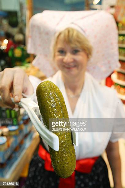 Ute Engelmann presents a gherkin from the Spreewald region 20 January 2008 at the 'Gruene Woche' international food and agriculture fair in Berlin 18...