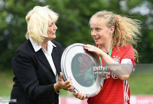 Ute Maass hand over the Championship Trophy to Andrea Brunner of FC Bayern Muenchen after the B Junior Girl's German Championship Final between FC...