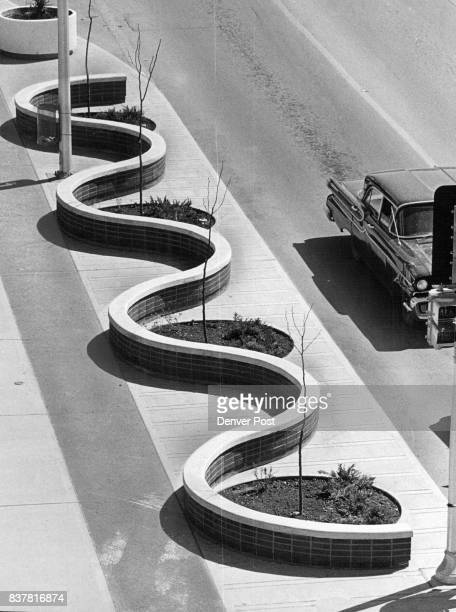 Utilities run under the dark strip inside the curving wall The covering is made of aggregate that can be torn up when repairs have to be made and...