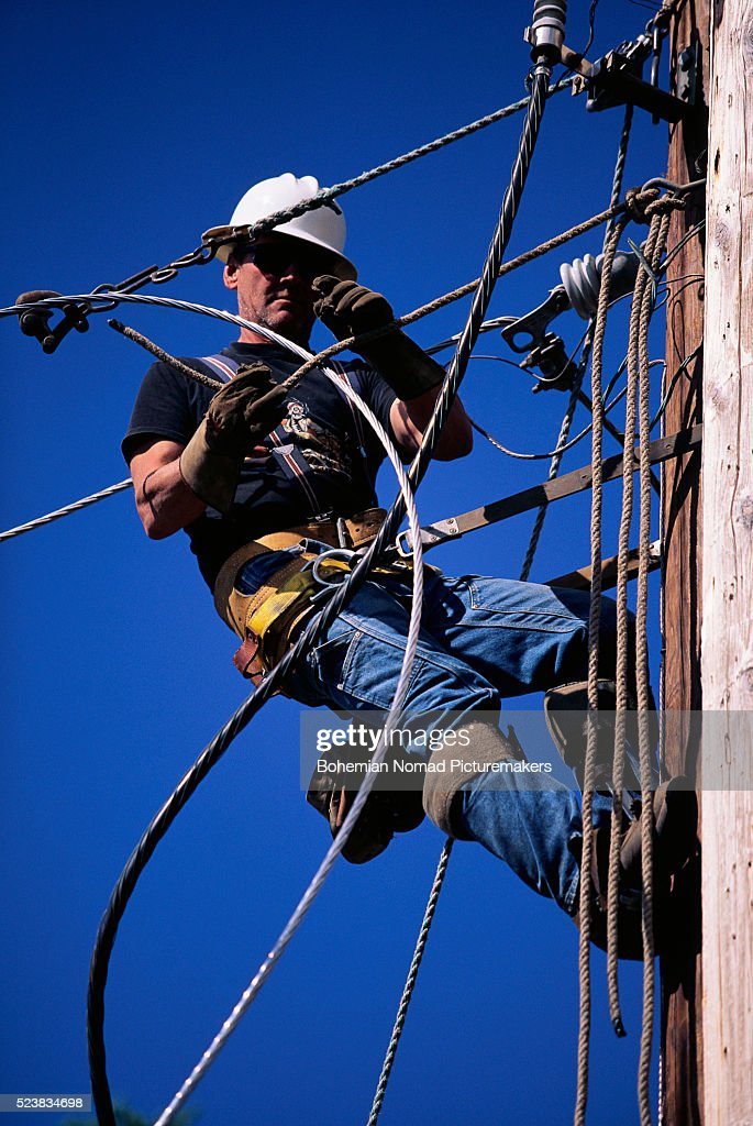 Utility Worker Fixing Power Line