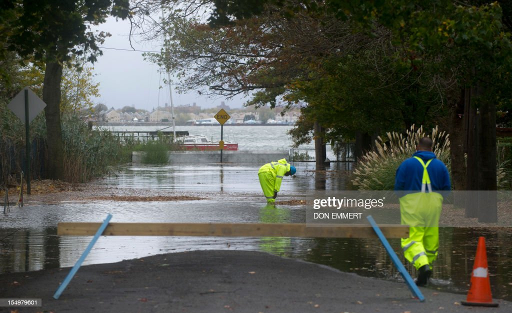Utility workers inspect gas lines on City Island October 29, 2012 in New York. Residents on the island were told to evacuate by New York City Mayor Bloomberg. Hurricane Sandy's winds picked up speed as the storm made a left turn toward the East Coast. AFP PHOTO/DON EMMERT