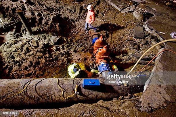 CONTENT] Utility workers repairing a broken water main at Division st and 10th st in SoMa district The contractors installed two large cutoff valves...