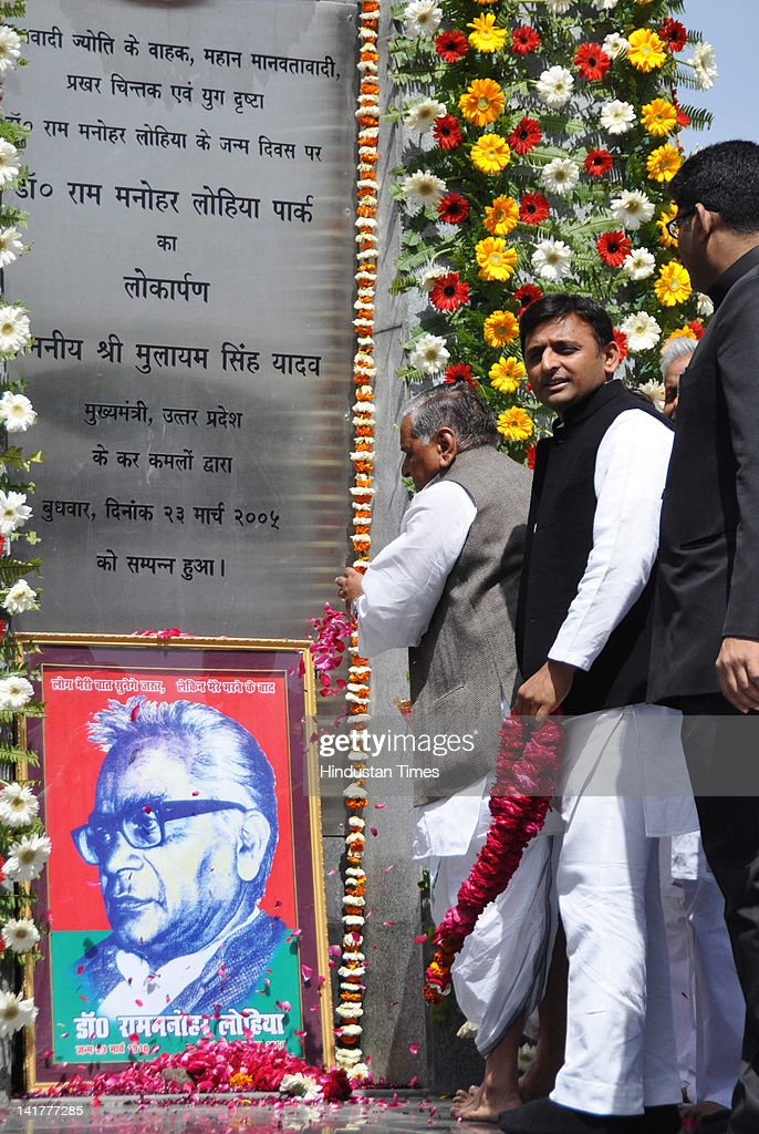 Uttar Pradesh Chief Minister Akhilesh Singh Yadav and Samajwadi Party Chief <a gi-track='captionPersonalityLinkClicked' href=/galleries/search?phrase=Mulayam+Singh+Yadav&family=editorial&specificpeople=689640 ng-click='$event.stopPropagation()'>Mulayam Singh Yadav</a> pay tribute to Ram Manohar Lohia on his 102nd birth anniversary at Lohia Park on March 23, 2012 in Lucknow, India. Hinting there might be midterm general election, the SP chief called on his party workers to work hard to ensure that the party win a maximum number of seats in the election.