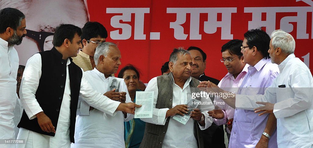 Uttar Pradesh Chief Minister Akhilesh Singh Yadav, Samajwadi Party (SP) Chief <a gi-track='captionPersonalityLinkClicked' href=/galleries/search?phrase=Mulayam+Singh+Yadav&family=editorial&specificpeople=689640 ng-click='$event.stopPropagation()'>Mulayam Singh Yadav</a> and other party leaders pay tribute to Ram Manohar Lohia on his 102nd birth anniversary at Lohia Park on March 23, 2012 in Lucknow, India. Hinting there might be midterm general election, the SP chief called on his party workers to work hard and ensure that party win maximum seat in elections.