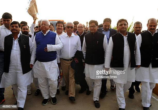 Uttar Pradesh Chief Minister Akhilesh Yadav along with his uncles Ram Gopal Yadav and Shivpal Singh Yadav greets RJD Chief Lalu Prasad on his arrival...