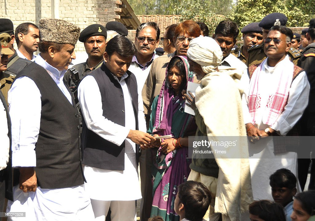 Uttar Pradesh Chief Minister Akhilesh Yadav and Cabinet Minister Azam Khan meeting the family members of Gram Pradhan Nanhey Yadav and his brother Suresh at Balipur village in Kunda area on March 6, 2013 in Pratapgarh district, India. Nanhey Yadav and Suresh were killed in the village on Saturday evening after that Deputy Superintendent of Police Zia-ul-Haque was also killed allegedly by a mob. The Chief Minister visited Kunda after the Gram Pradhan's family staged a sit-in, demanding that he meet them. Chief Minister handed over cheques worth Rs 20 lakh each to family members of slain Gram Pradhan.