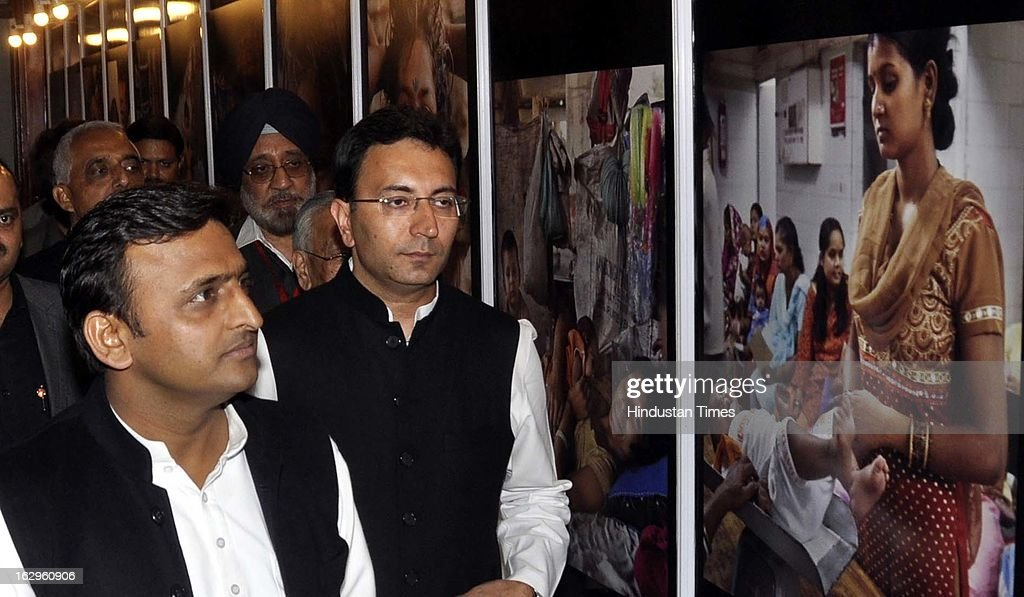 Uttar Pradesh Chief Minister Akhilesh Yadav and Union Minister of State for Human Resource Development Jitin Prasada viewing an exhibition of photographs by Raghu Rai at the 'No Child Born to Die' summit organised by Hindustan Times and Save the Children at Hotel Taj on March 2, 2013 in Lucknow, India.