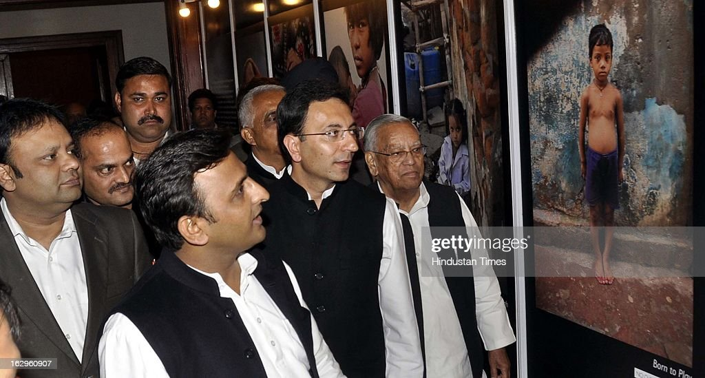 Uttar Pradesh Chief Minister Akhilesh Yadav, Union Minister of State for Human Resource Development Jitin Prasada and UP Health and Family Welfare Minister Ahmad Hasan viewing an exhibition of photographs by Raghu Rai at the 'No Child Born to Die' summit organised by Hindustan Times and Save the Children at Hotel Taj on March 2, 2013 in Lucknow, India.