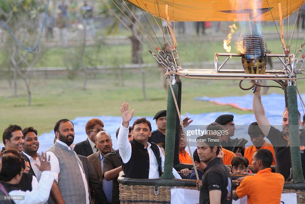 Uttar Pradesh Chief Minister Akhilesh Yadav waves his hand after sitting on hot air balloon during a Balloon festival as a part of 'State Tourism Day' on Tourism day here at Janeshwar Mishra Park on February 14, 2016 in Lucknow, India. Uttar Pradesh Tourism Department has decided to celebrate its own 'State Tourism Day' annually on the Valentine's Day, February 14. The first 'State Tourism Day' will be celebrated in Lucknow but the venue will change to other cities in coming years, Navneet Sehgal, Principal Secretary Tourism added.