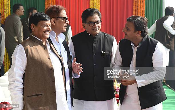 Uttar Pradesh Chief Minister Akhilesh Yadav with his uncles and politicians Shivpal Yadav and Ram Gopal Yadav and Minister Azam Khan during the...