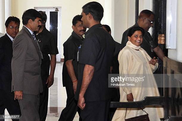Uttar Pradesh Chief Minister Mayawati arrives at Governor Banwari Lal Joshi's residence to submit her resignation on March 7 2012 in Lucknow India...