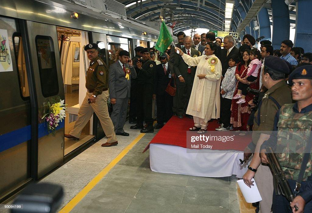 Uttar Pradesh Chief Minister Mayawati (R) flags off the metro from Noida City Centre station, as Delhi Metro Rail Coorporation (DMRC) Managing Director Elattuvalapil Sreedharan (2 R) looks on,in Noida on Thursday, November 12, 2009.