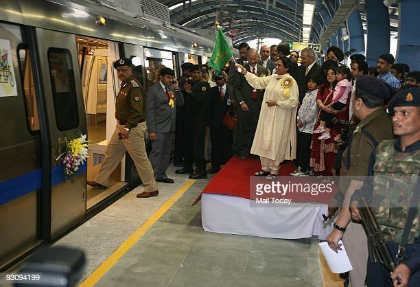 Uttar Pradesh Chief Minister Mayawati flags off the metro from Noida City Centre station as Delhi Metro Rail Coorporation Managing Director...