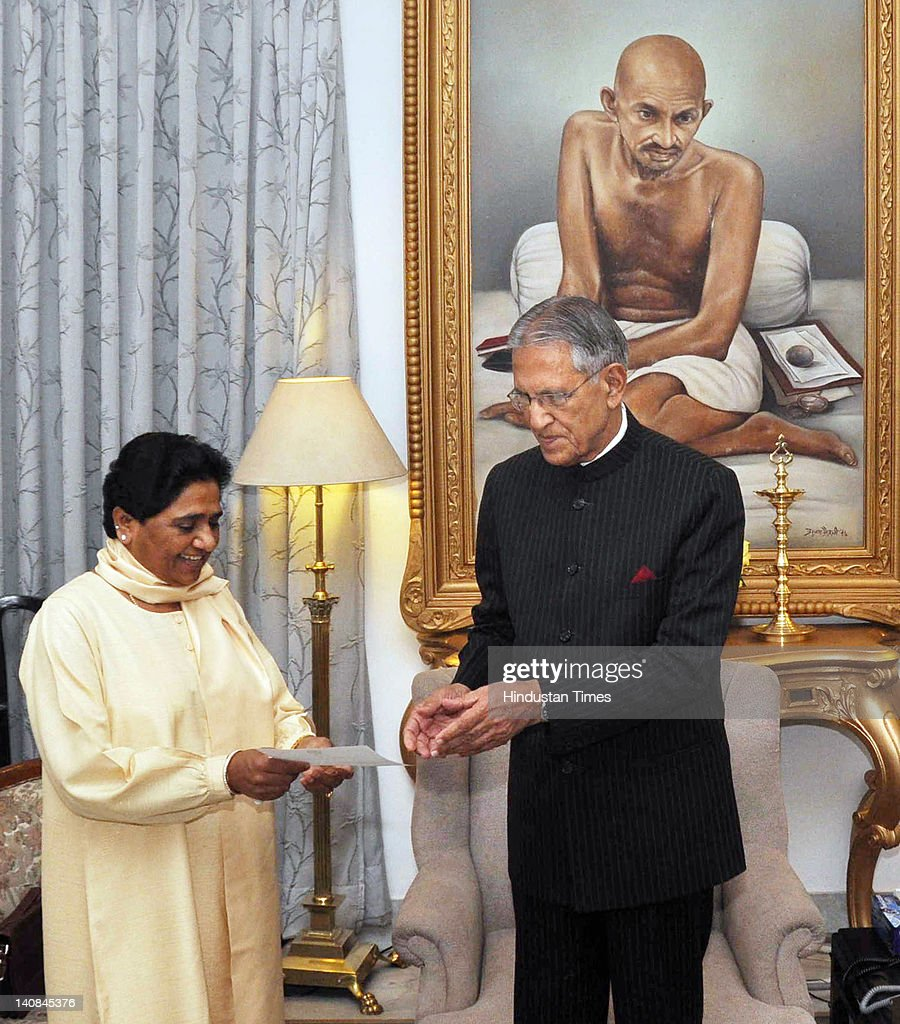 Uttar Pradesh Chief Minister Mayawati (L) presents her resignation to Governor Banwari Lal Joshi at his residence on March 7, 2012 in Lucknow, India. Mayawati leads the Bahujan Samaj Party, which was routed in Uttar Pradesh assembly elections where the party managed only 80 out of 406 assembly seats.