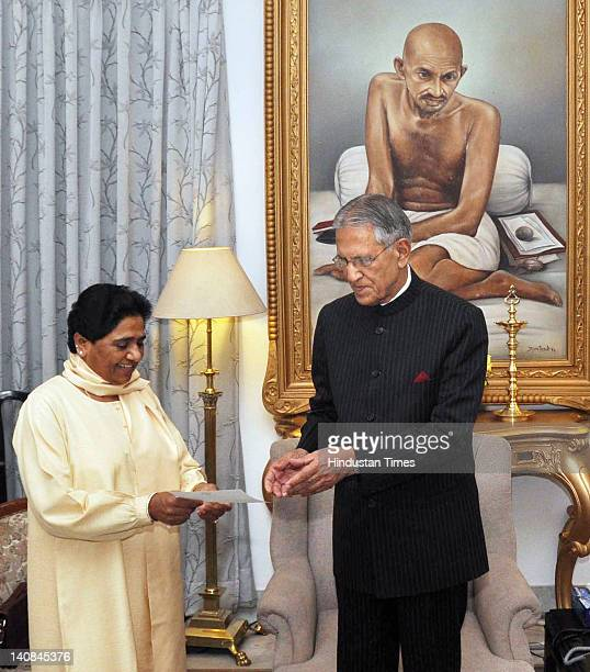 Uttar Pradesh Chief Minister Mayawati presents her resignation to Governor Banwari Lal Joshi at his residence on March 7 2012 in Lucknow India...