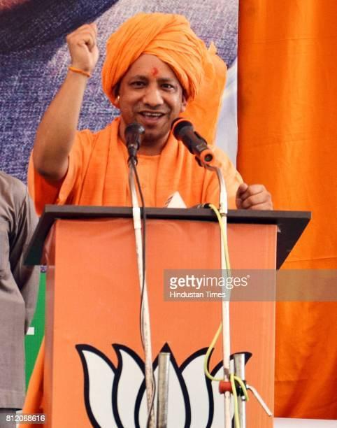 Uttar Pradesh Chief Minister Yogi Adityanath addresses gathering during the closing ceremony of BJP's Parivartan Rath Yatra on July 10 2017 in Una...