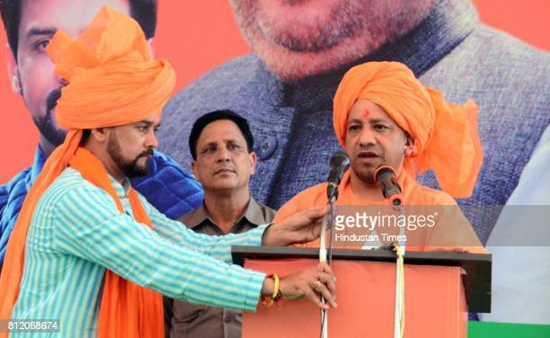 Uttar Pradesh Chief Minister Yogi Adityanath addresses gathering during the closing ceremony of BJP's Parivartan Rath Yatra on July 10 2017 in Una...
