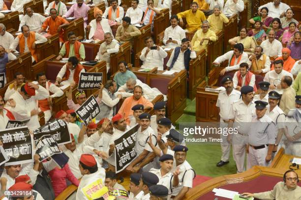 Uttar Pradesh Chief Minister Yogi Adityanath looks as opposition members created ruckus in the Assembly on the first day of the state legislature...