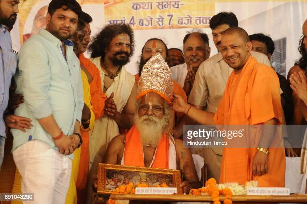 Uttar Pradesh Chief Minister Yogi Adityanath offers silver crown to Mahant Nritya Gopal Das during his 79th birthday function on May 31 2017 in...