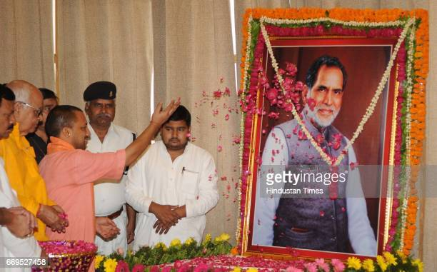 Uttar Pradesh Chief Minister Yogi Adityanath paying floral tribute to former Prime Minister Chandra Shekhar on his 91st birth anniversary at Assembly...