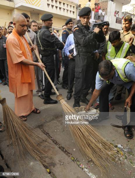 Uttar Pradesh Chief Minister Yogi Adityanath sweeping a street in a slum area in Balu Adda locality to kickstart a cleanliness campaign to encourage...