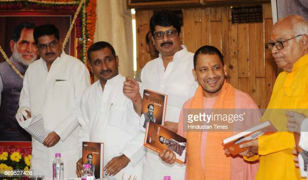 Uttar Pradesh Chief Minister Yogi Adityanath Vidhan Sabha Speaker Hridaya Narain Dixit and former minister Raghuraj Pratap Singh alias Raja Bhaiya...