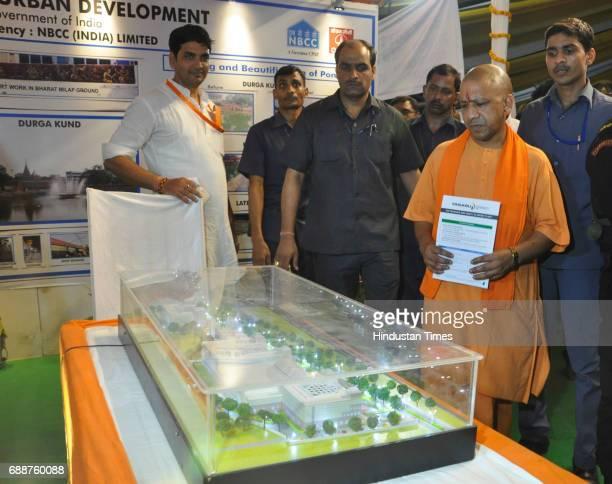 Uttar Pradesh Chief Minister Yogi Adityanath views the exhibition at the memorial school Nadesar on May 26 2017 in Varanasi India