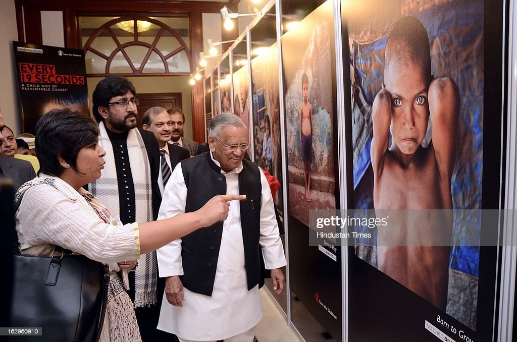Uttar Pradesh Health Minister Ahmad Hasan takes a look at photo exbhition of Raghu Rai at the 'No Child Born to Die' summit organised by Hindustan Times and Save the Children at Hotel Taj on March 2, 2013 in Lucknow, India.