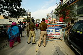 Uttar Pradesh police barricading the road leading to Aam Aadmi Party office in Kaushambi after the attacked by Hindu Raksha Dal on January 8 2014 in...
