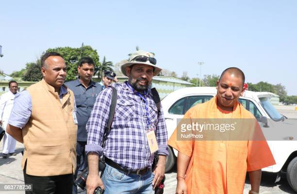 Uttar Pradesh state chief Minister Aditya Nath Yogi speaks with Photojournalist Rajesh Kumar Singh at Allahabad Airport on April 22017