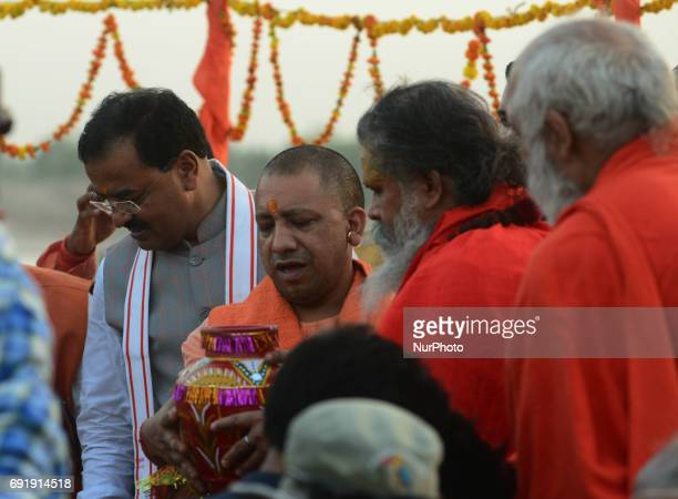 Uttar Pradesh state chief minister Yogi Adityanath offers prayers at holy sangam confluence of Ganges Yamuna and mythical Saraswati river during his...