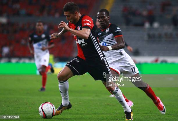 Uvaldo Luna of Atlas and Luis Advincula of Lobos BUAP fight for the ball during the 6th round match between Atlas and Lobos BUAP as part of the...