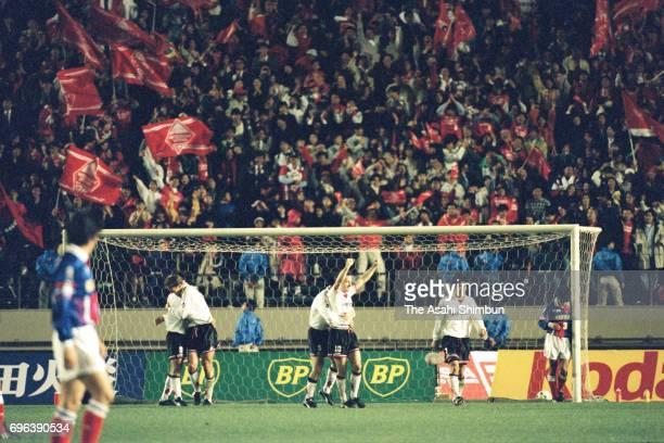 Uwe Bein of Urawa Red Diamonds celebrates scoring the vgoal with his team mates during the JLeague match between Yokohama Marinos and Urawa Red...