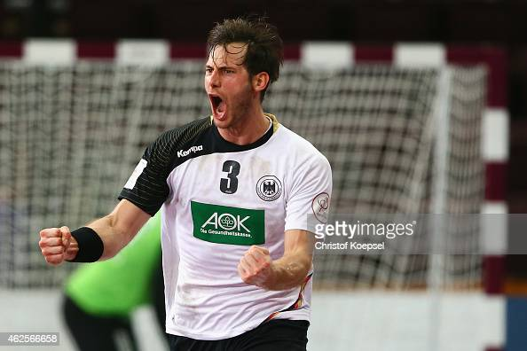 Uwe Gensheimer of Germany celebrates a goal during the eighth place match between Germany and Slovenia in the Men's Handball World Championship at...