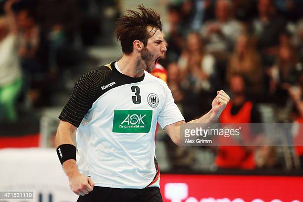 Uwe Gensheimer of Germany celebrates a goal during the European Handball Championship 2016 Qualifier match between Germany and Spain at SAP Arena on...