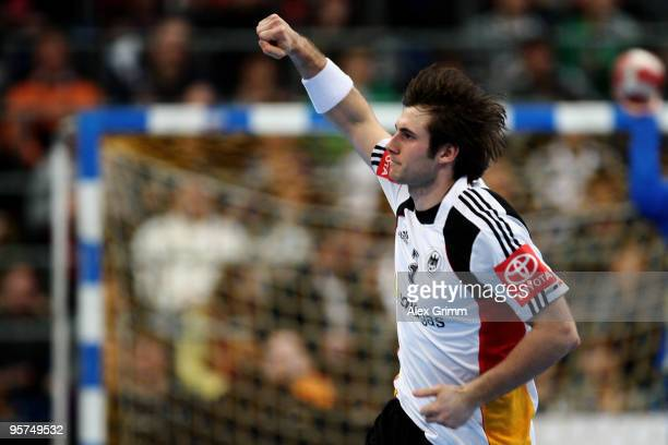 Uwe Gensheimer of Germany celebrates a goal during the international handball match between Germany and Brazil at the SAP Arena on January 13 2010 in...