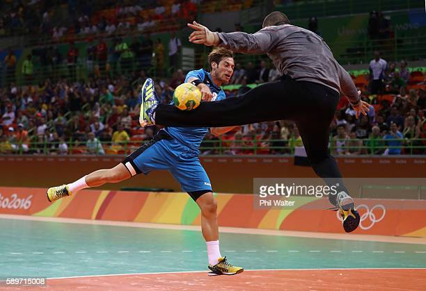 Uwe Gensheimer of Germany shoots at goal against Karim Hendawy of Egypt during the Men's Preliminary Group B match between Germany and Egypt on Day...